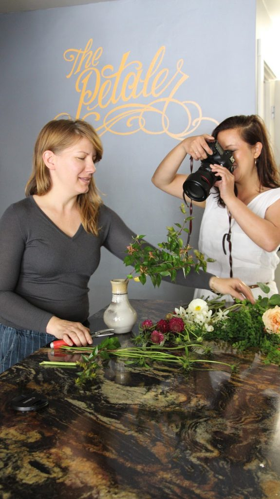 Rebekah jushes florals as Leslie wields her camera