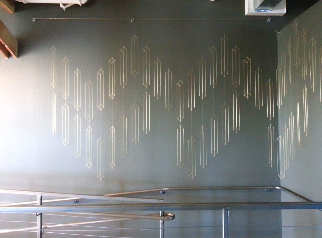 Brass Installation Art by Beth Naumann in Stripe, San Francisco, CA.