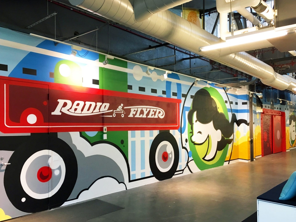 Radio Flyer red wagon HQ! Murals by Anthony Lewellen in their Chicago offices.