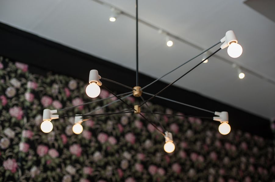 Close up of Cord Chandelier as lighting fixture by creator Brendan Ravenhill in Alfred Coffee cafe space in Los Angeles.