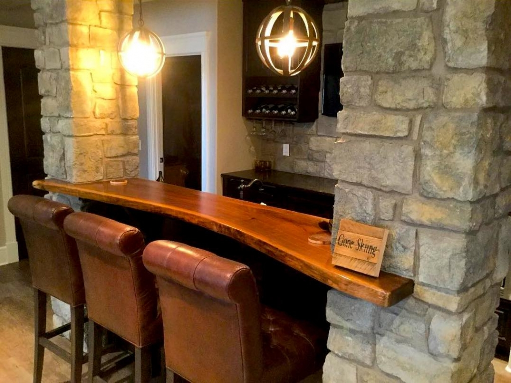 Live edge black walnut bar top custom built by Black Forest Wood Co. suits perfectly for a customer's new home.