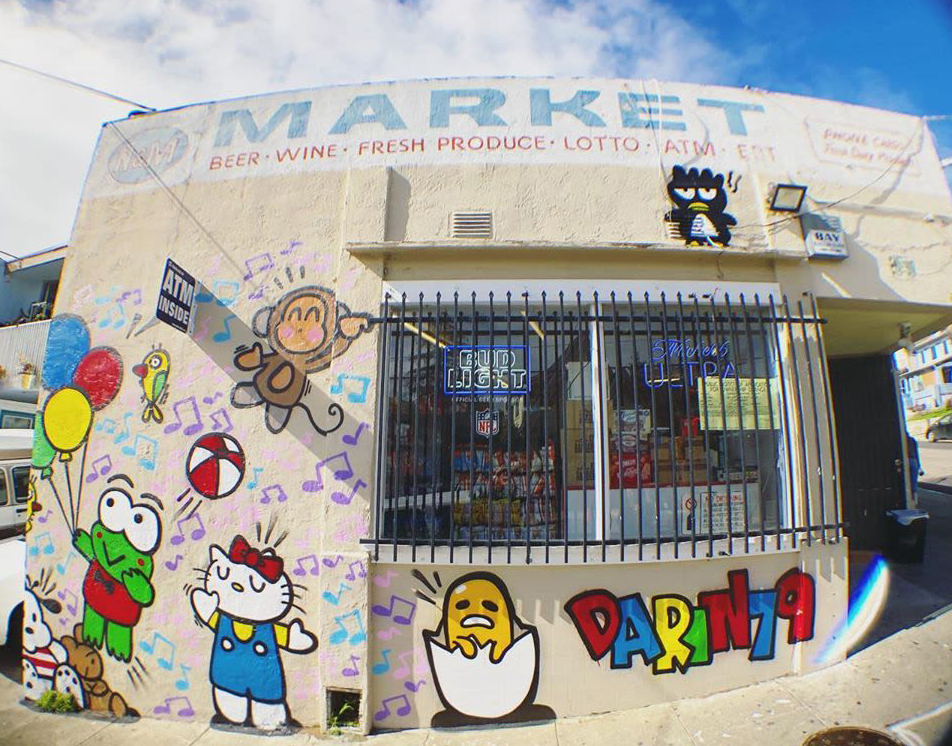 Sanrio Song by Darin at N&M Market, Oakland, CA. Bright and Colorful 90's inspired Cartoon characters on the facade of market.