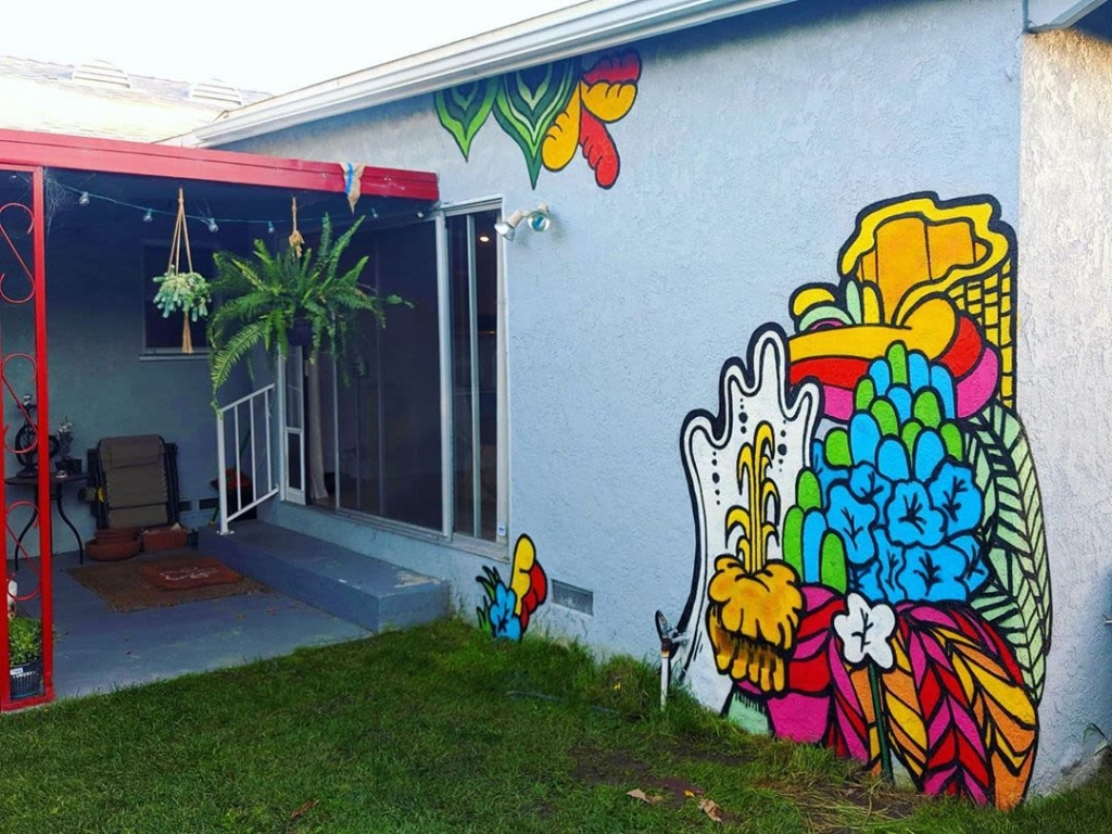 Mural by Darin on the side of a private residence in Culver City, CA. Bright Colors, 70's Vibe Plants.