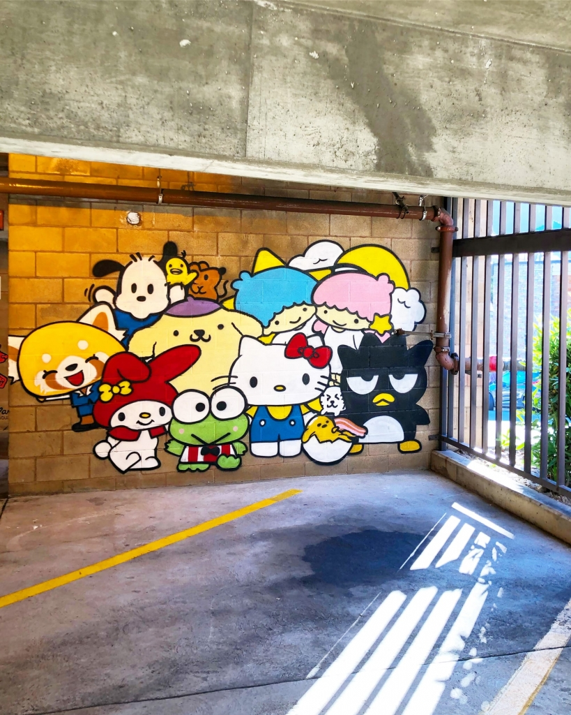 Darin's mural at Montclair Parking Garage, Oakland, CA right next to Darin's childhood home. Hello Kitty character and other 90's inspired cartoons