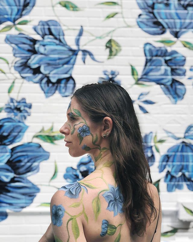 Natasha aka Surface of Beauty in front of her mural located at Yumi Kim, New York, NY