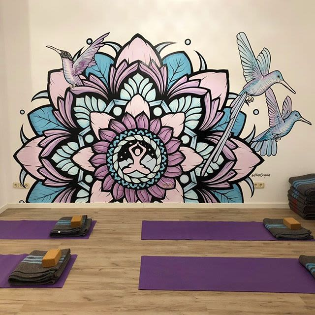 colorful mandala purple and blue wall mural with birds and flowers at a yoga studio