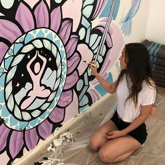 Colorful Mandala purple and blue  wall mural with flowers and birds in a yoga studio