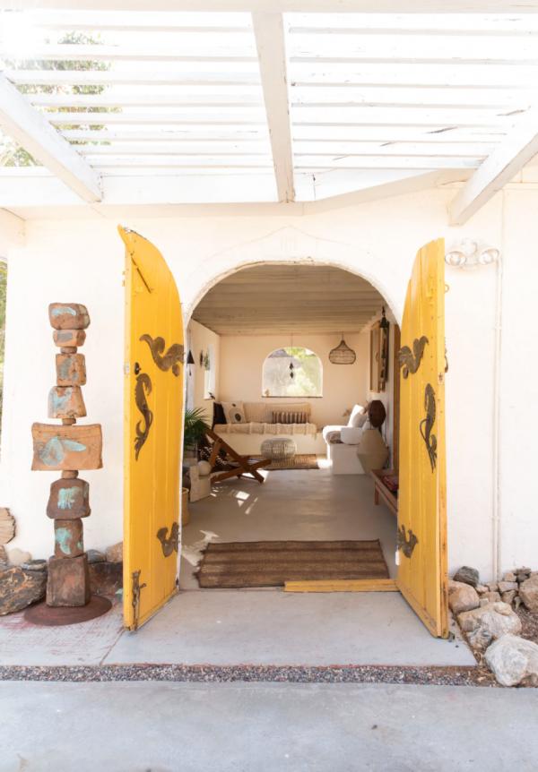 yellow open doors to living room