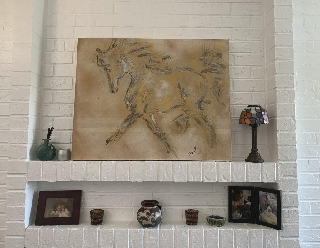 Golden painting of horse trotting