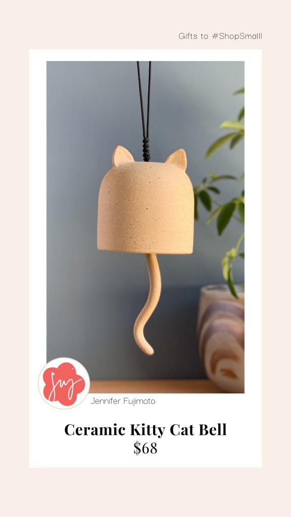 Ceramic cat bell sculpture