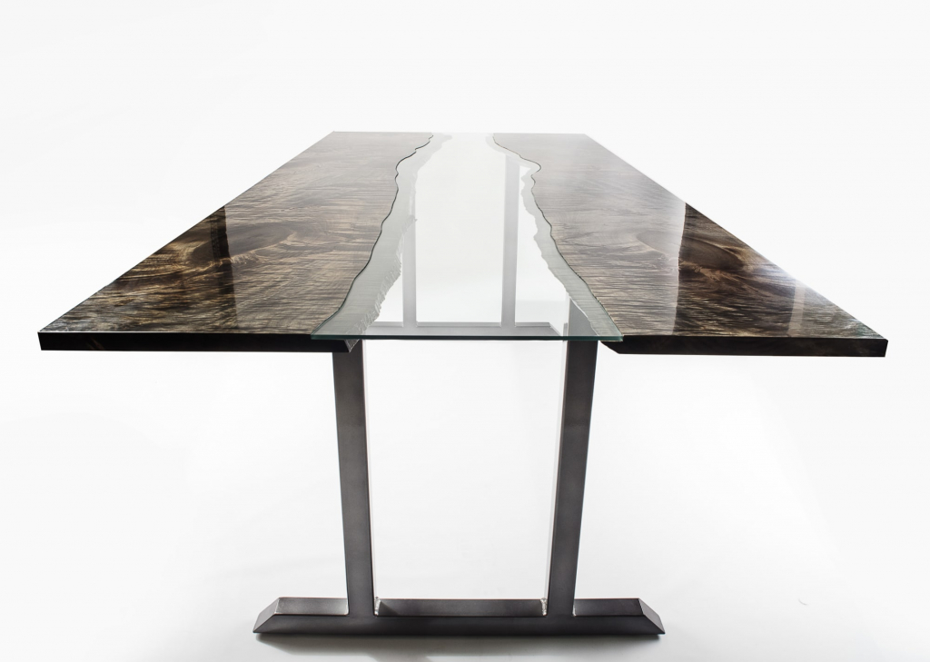 An ebonized maple bookmatched river style modern dining table by Lumberlust Designs.