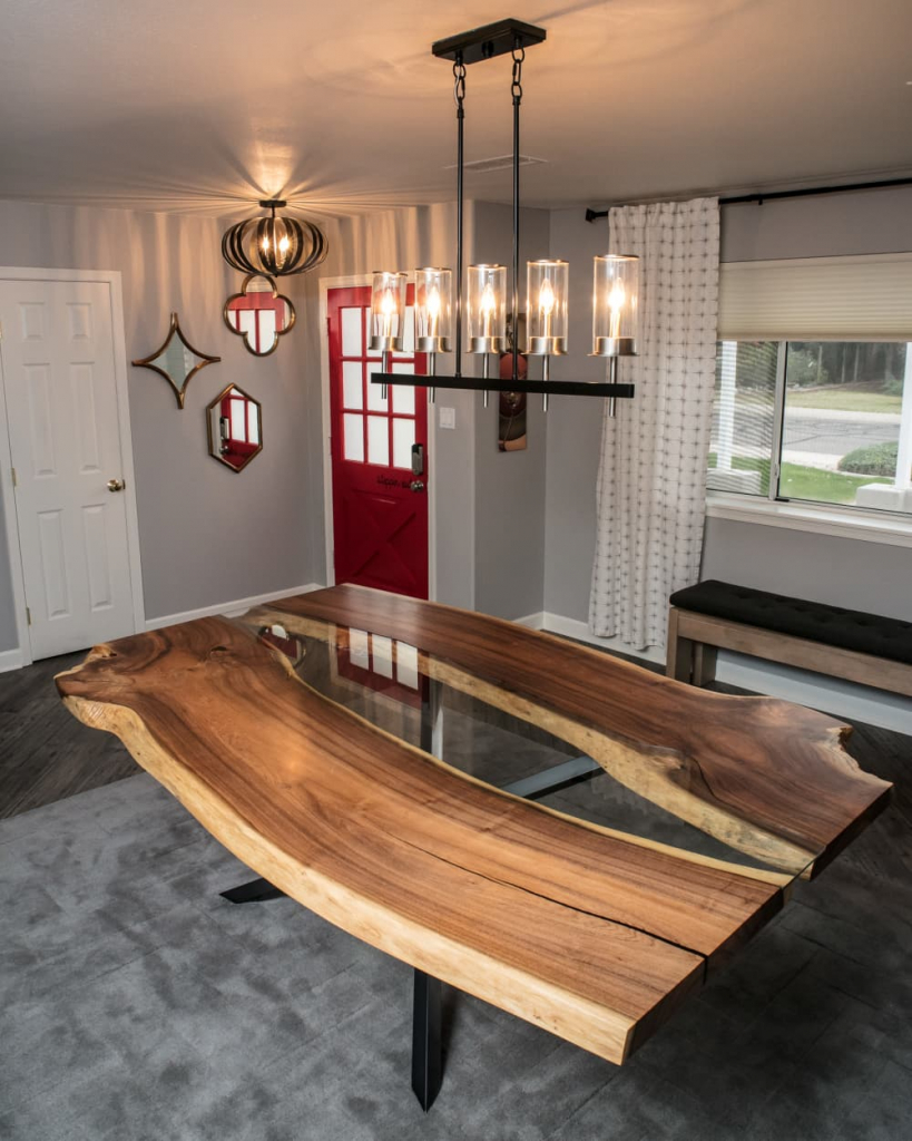 A mesquite live edge river table by Lumberlust Designs.