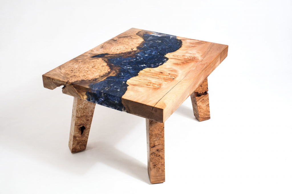 A maple burl sodalite mineral resin river coffee table by Lumberlust Designs.