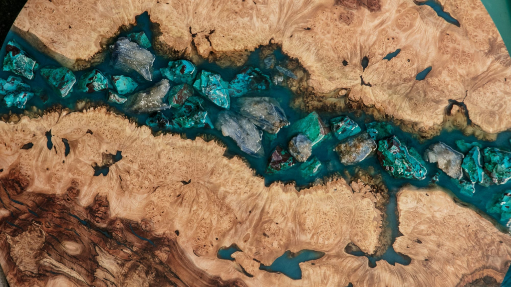 A close-up of a maple burl resin river with Chrysocolla and Kyanite inlay by Lumberlust Designs.