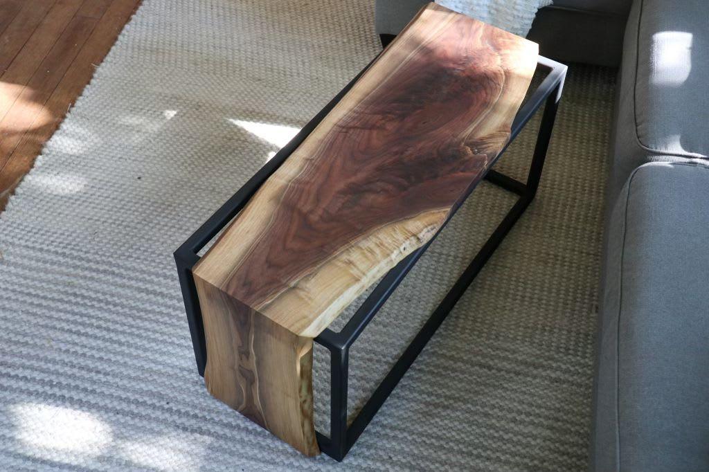 A live edge walnut waterfall coffee table by Hazel Oak Farms.