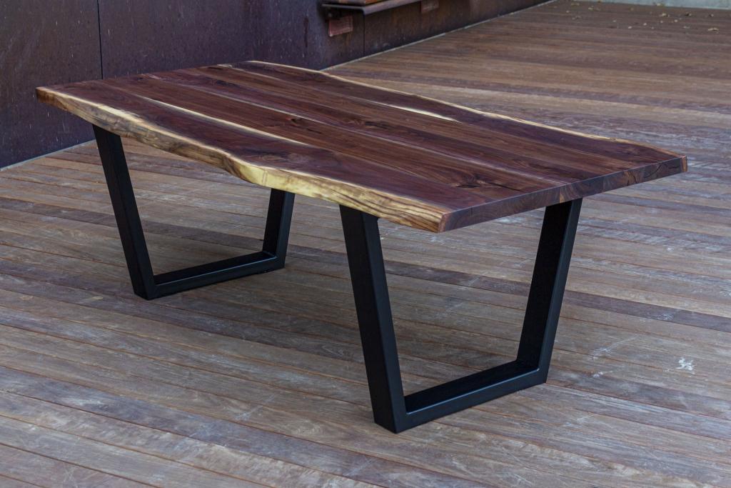 A live edge walnut industrial table by Hazel Oak Farms.