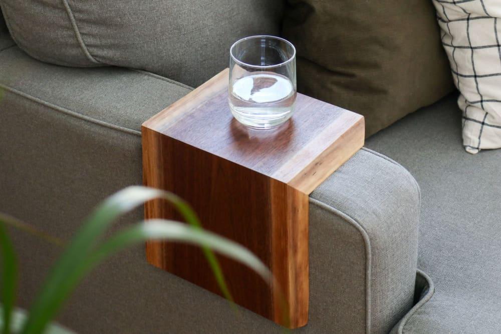 A live edge walnut armrest table by Hazel Oak Farms.