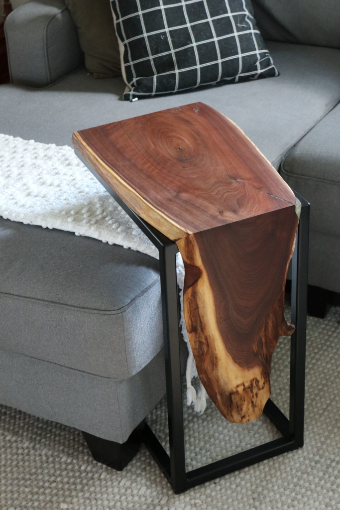 A live-edge walnut waterfall C-table by Hazel Oak Farms.