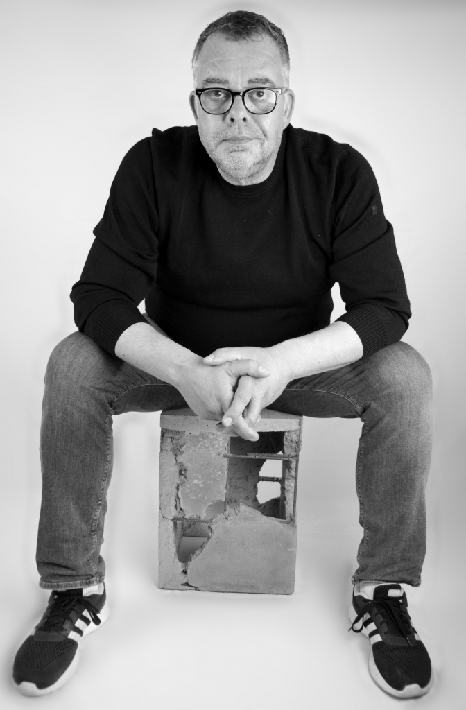 Wescover Creator Stephan Schmitz sits on one of his concrete coffee tables.