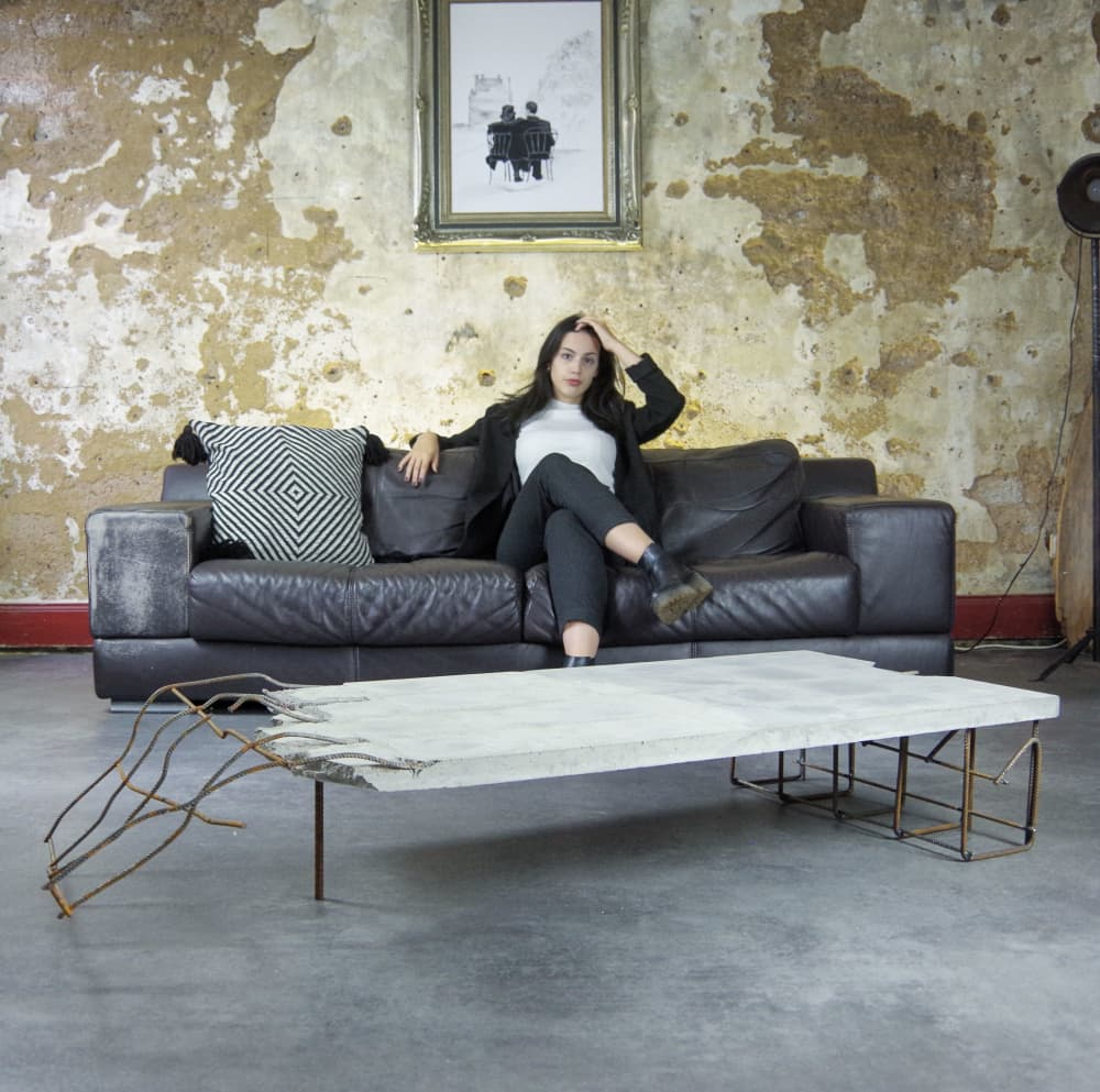 The Frakes Table on Wescover by Stephan Schmitz incorporates metal and concrete for a one-of-a-kind design.